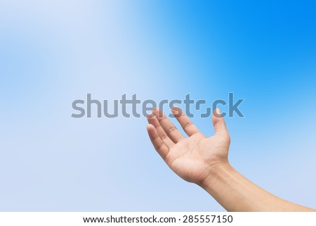 Right hand with empty on blurred blue backgrounds with selective focus,soft focused - stock photo
