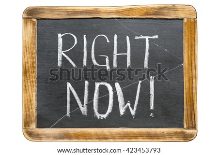 right now exclamation handwritten on vintage school slate board isolated on white