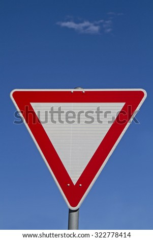 Right of way grant - often mounted at junctions give way sign - stock photo