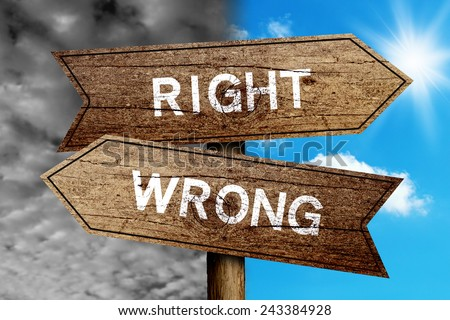 Right Or Wrong concept road sign with cloudy and sunny sky background. - stock photo
