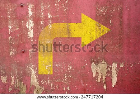 Right turn road sign painted on wall,vintage wall background - stock photo
