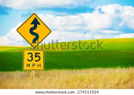 Right Winding Road with Sharp Turn Symbol. Roadside Curved Road Sign. - stock photo