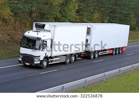 RIIHIMAKI, FINLAND - SEPTEMBER 26, 2015: Renault T reefer truck drives along motorway. Refrigerated trucks can haul a variety of goods that require climate-controlled handling. - stock photo