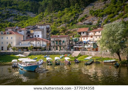 Rijeka Crnojevica old town embankment and river excursions boats moored. Starting point of Skadar lake touristic boat trips. Montenegro.