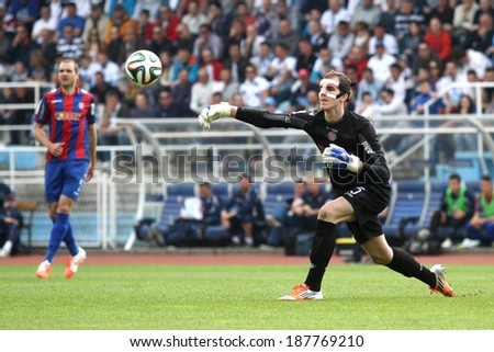 RIJEKA, CROATIA APRIL 06: soccer derby match NK Rijeka (white) vs. NK Hajduk Split (blue) on July 06, 2014 in Rijeka. Hajduk's goalkeeper Dante Stipica is throwing a ball.