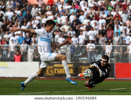 RIJEKA, CROATIA APRIL 06: soccer derby match NK Rijeka (white) vs. NK Hajduk Split on July 06, 2014 in Rijeka. Rijeka's Ivan Krstanovic and Hajduk's goalkeeper Dante Stipica try to reach the ball.
