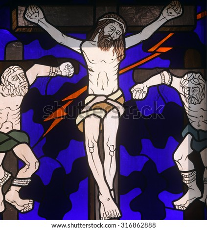 RIJEKA, CROATIA - JUNE 11: 12th Stations of the Cross, Jesus dies on the cross , stained-glass window in the church of St. John the Baptist in Rijeka, Croatia, on June 11, 2011 - stock photo