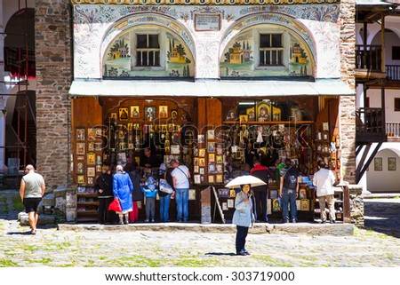 Rila, Bulgaria - June, 25, 2015: People near the icon shop in Unesco World Heritage site famous Rila Monastery, Rilsky monastery  - stock photo