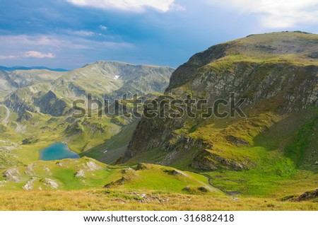 Rila mountain landscape with mountains and lake - stock photo