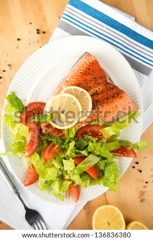 rilled Salmon Fillet Served with Tomatoes and Romaine Salad - stock photo