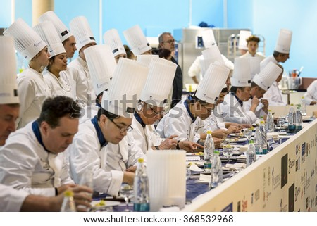 RIMINI, ITALY - 23 JANUARY 2016 - Editorial: jury chef who is considering one of the dishes in the race for the world championship of ice cream - stock photo