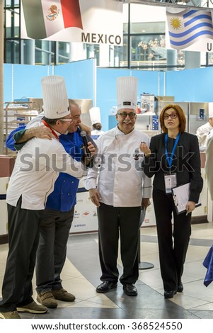 RIMINI, ITALY - 23 JANUARY 2016 - Editorial: the presenter of the championship worlds of ice cream interviewing chefs - stock photo