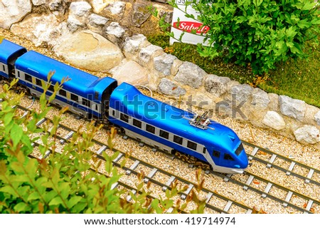 RIMINI, ITALY - MAY 11, 2016: Italian train at the  Italy in miniature, a thematic park in Emilia Romagna. It was found by Ivo Rambaldi in 1970