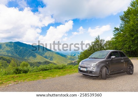 RIMONT, FRANCE - JULY 24, 2014: A Fiat 500 (Type 312) hatchback parked in the French Pyrenees.  The Fiat 500 is a city car built by Italian automaker Fiat since 2007. - stock photo
