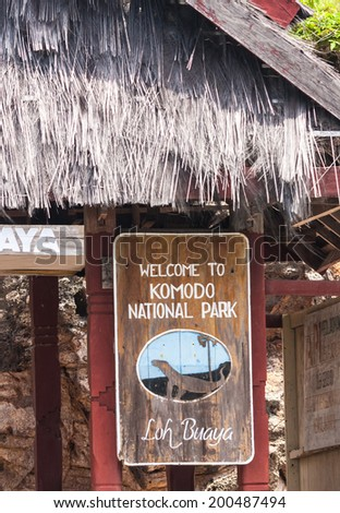 Rinca island, Indonesia - January 15 2011: A wooden sign indicates the entrance of the Komodo National park, home to the famous Komodo dragons in Indonesia - stock photo