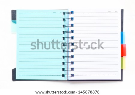 ring binder notebook with green bookmark on white background