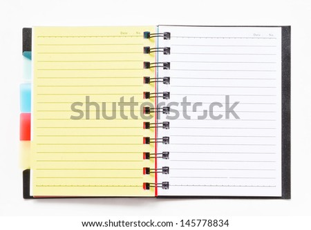 ring binder notebook with yellow bookmark on white background