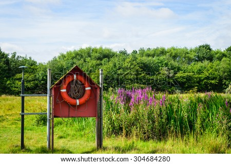 Ring buoy in the park - stock photo