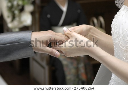 Ring exchange of church-type, than the bride to the groom - stock photo