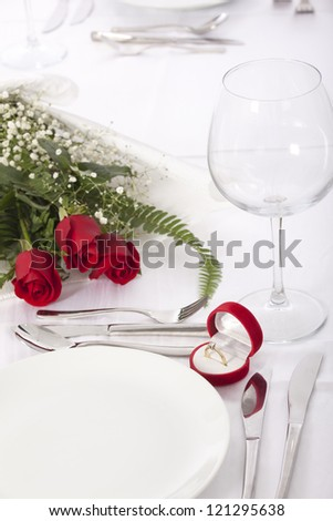 Ring in gift box on celebratory table of Valentine's Day - stock photo