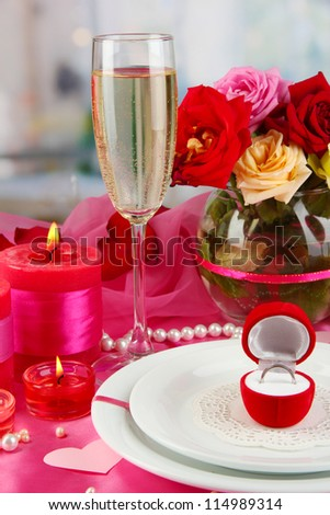 Ring in gift box on celebratory table  of Valentine's Day on room background