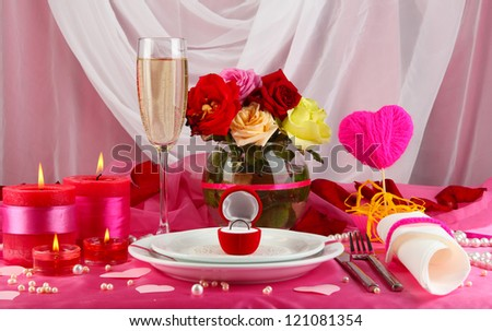 Ring in gift box on celebratory table  of Valentine's Day on white fabric background - stock photo