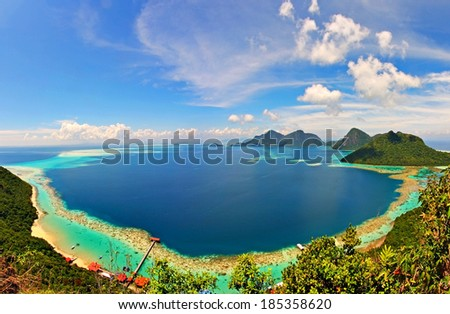 Ring of corals seen from the peak of Bohey Dulang Island, Sabah, Malaysia. - stock photo