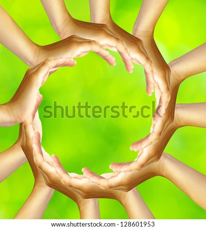ring of hands isolated on a green