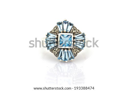ring of the jeweler with blue sapphire and brilliants on a white background - stock photo