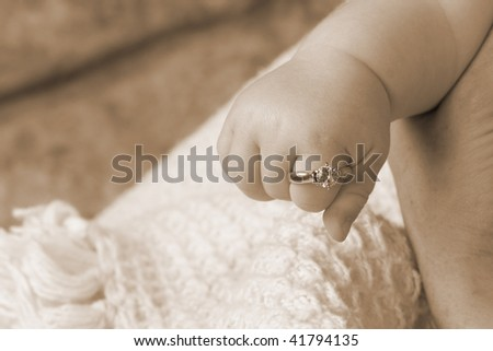 Ring On Baby Finger - stock photo