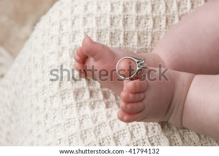 ring on Baby toes