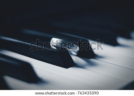 Ring on Black and White Keys of Piano