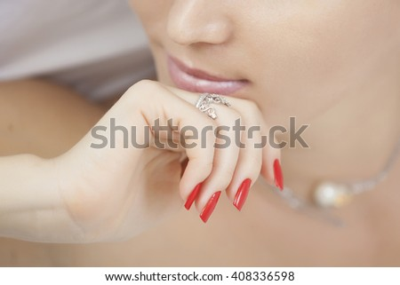 Ring on her finger at the girl close-up