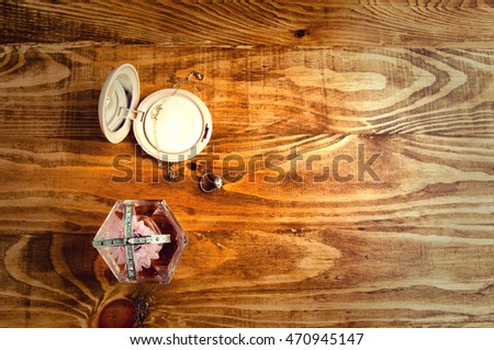 ring, perfume on a wooden background