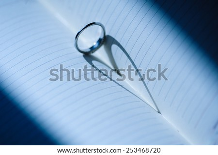 ring with a heart-shaped shadow. - stock photo