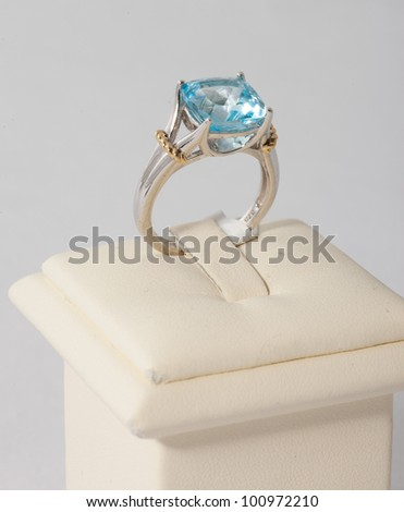 Ring with blue stone on display stand - stock photo