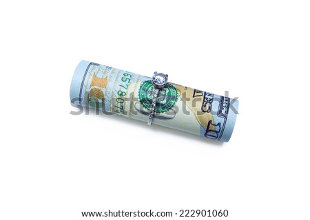 Ring with diamond on the banknote. Money on the white background. One hundred dollars. - stock photo