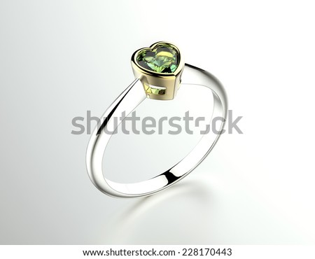 Ring with emerald heart shape. Jewelry background