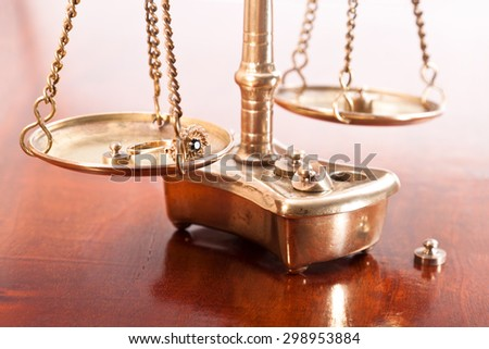 Ring with precious stones on the scales - stock photo