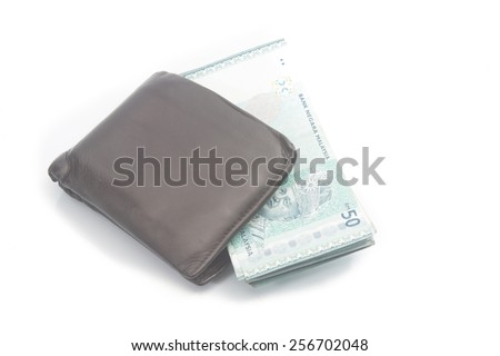 Ringgit Money in leather purse isolated on white background - stock photo