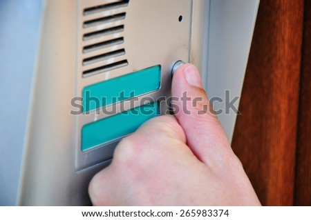 Ringing doorbell, visitor door bell - stock photo