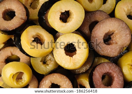 rings green and black sliced olives background.  - stock photo