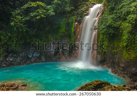 Rio Celeste Waterfall photographed in Costa Rica. - stock photo