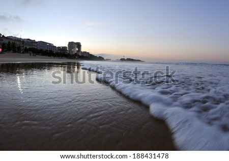 Rio de Janeiro, April 20, 2014 - Early morning sun on Ipanema beach in the city of Rio de Janeiro.