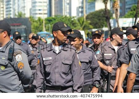 RIO DE JANEIRO, APRIL 17, 2016: Police during protests in Brazil against Dilma Roussef's impeachment in Copacabana beach. - stock photo