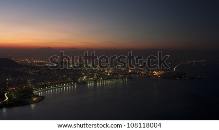 Rio de Janeiro at sunset, view from Sugarloaf mountain - stock photo
