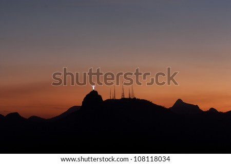 Rio de Janeiro at sunset, view from Sugarloaf mountain on Corcovado mountain and Christ the redeemer statue - stock photo