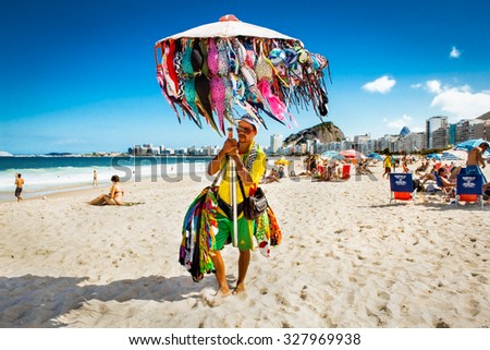 RIO DE JANEIRO, BRAZIL - APRIL 28, 2015: Brazilian street vendor sells swimsuit on April 28, 2015 at Copacabana Beach, Rio de Janeiro. Brazil. - stock photo