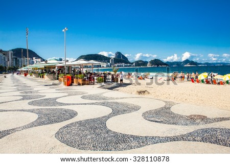 RIO DE JANEIRO, BRAZIL - APRIL 24, 2015: Iconic sidewalk tile pattern at Copacabana Beach on April 24, 2015 in Rio de Janeiro. Brazil. - stock photo