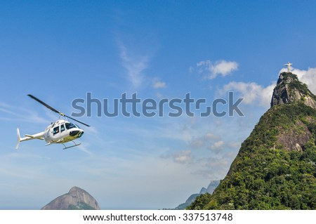 RIO DE JANEIRO, BRAZIL - APRIL 11, 2012: View of Christ the Redeemer and a helicopter from below, Rio de Janeiro, Brazil - stock photo